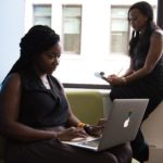 Two women working together on blogging for their business.